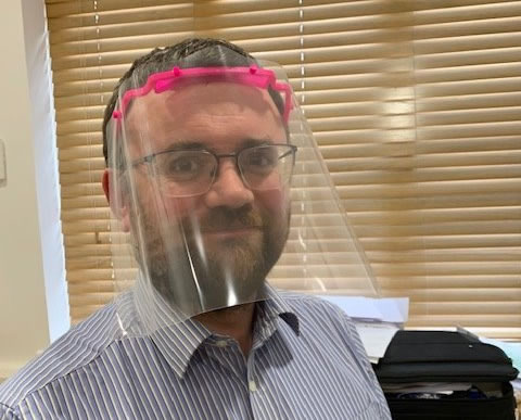 GP wearing 3D Printed Clips for NHS Face Shields
